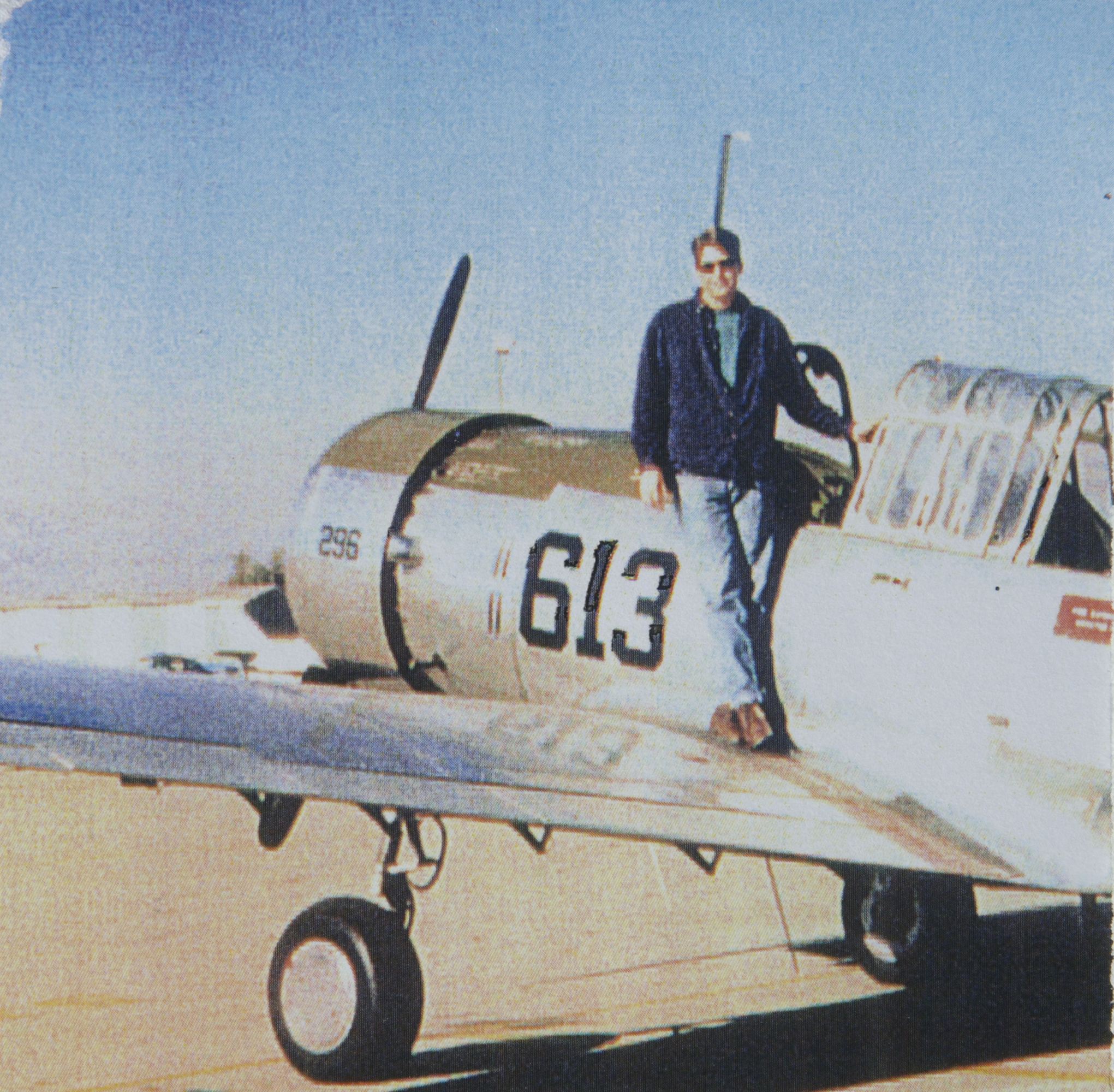 young man on wing of world war two wwii era aircraft airplane