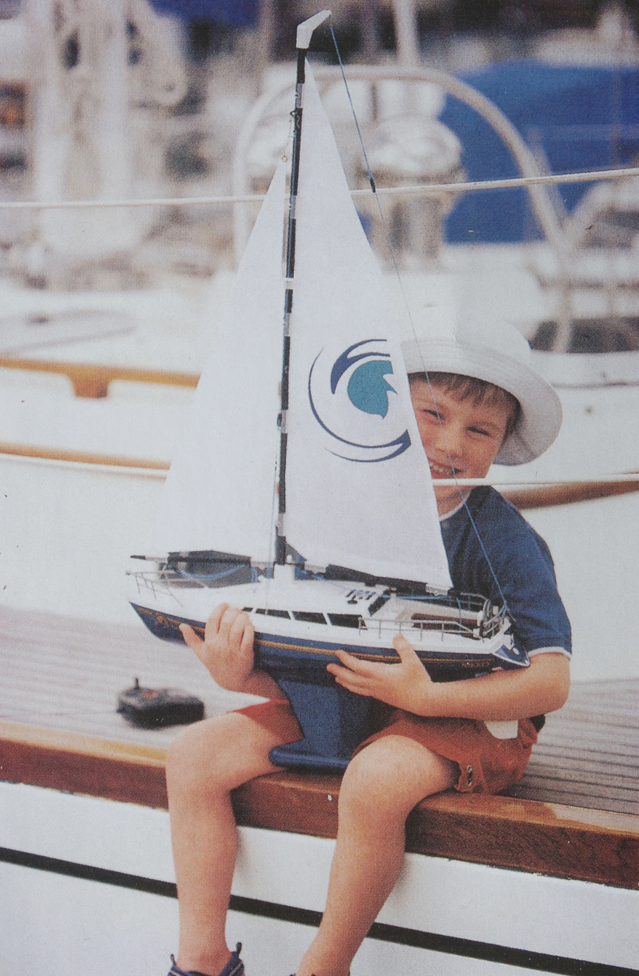 boy with toy yacht
